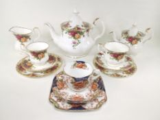 A quantity of Royal Albert tea wares in the 'Old Country Roses' pattern, to include two teapots in