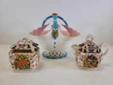A late 19th or early 20th Century European porcelain basket with turquoise, pink and gilt on a white