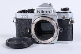 A Nikon FE2 Camera body, chrome, serial no 2023038, shutter working, meter responsive, self timer