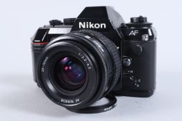 A Nikon F 501 SLR Camera, serial no 5193669, powers up, shutter working, appears to function as