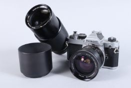 A Nikon FM SLR Camera, chrome, serial no 2440452, shutter working, meter responsive, self timer
