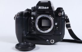 A Nikon F4 Camera Body, serial no 2258779, powers up, appears to function as should, shutter