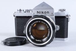 A Nikon F SLR Camera, chrome, serial no 6583069, prism viewfinder, shutter working, self timer