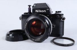 A Nikon F2 Photomic SLR Camera, black, serial no 7359217, shutter working, self timer working,