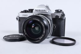 A Nikon FM2 SLR Camera, chrome, serial no 7206888, shutter working, meter responsive, self timer
