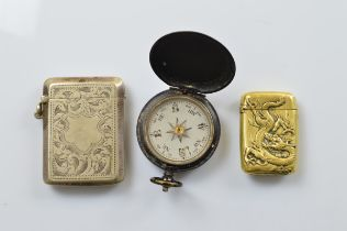An Edwardian electro plated vesta case, a Japanese Meiji period brass vesta case and an Edwardian