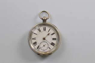 A continental open faced white metal fob watch, roman numerals, seconds subsidiary, 5cm diameter,