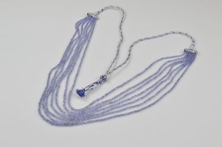 A certificated seven strand multi bead tanzanite necklace, the faceted beads of slightly graduated