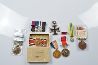 A George VI police medal, awarded to William E Hughes of Northumberland Force 666, a group of