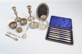 A collection of silver and silver plated ware, including a pair of silver dwarf candlesticks, 14cm