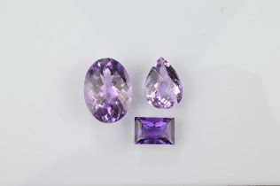 Three certificated loose amethysts, comprising a Uruguayan baguette cut 7.8ct, an oval 27ct and a