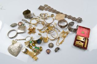 A quantity of costume jewellery, including an electro plated belt, various continental bangles,