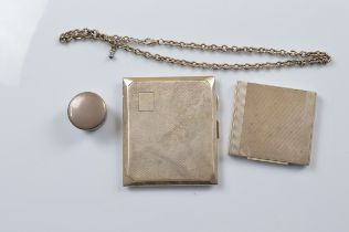 A silver compact with engine turned ribbed design, a silver cigarette case white metal chain and a