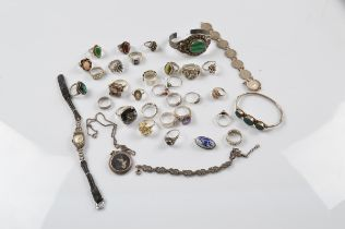 A collection of silver jewellery, including paste set rings, with tiger's eye, smoky quartz,