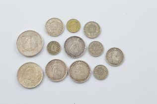 A small collection of Swiss coinage, including a commemorative silver Helvetia 20 franc bicentenary,