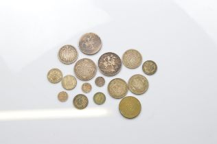 A collection of silver Georgian and Victorian coins, including a George III crown, a Victorian