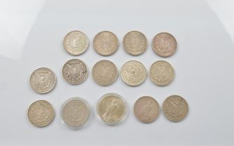 A collection of fourteen Morgan head and Liberty United States of America dollars, earliest 1890,