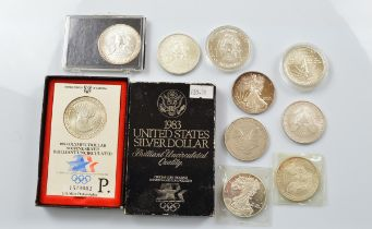 A collection of American contemporary silver dollars, including various commemorative examples for