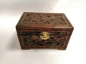 A table top camphor wood chest, with a carved phoenix and dragon design, 19cm x 30cm x 20cm