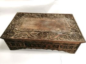 A late 19th Century Chinese carved box table, carved with auspicious symbols and dragons, 72cm x