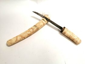 A Japanese Meiji period sword in ivory sheaf, with profusely carved decoration of Immortals, one
