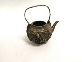 A Chinese teapot of squat form with a design of five Immortals amidst clouds, height 14cm, lacking