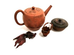 A Chinese Yixing stoneware teapot with raised figures holding parasols in a European influenced