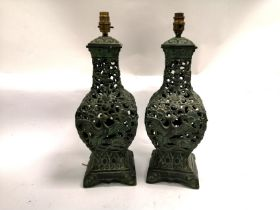 A pair of Chinese cast metal lamp bases with a design of phoenixes and dancing boys, height 50cm