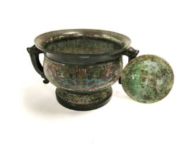 An interesting Chinese cast bronze censer or food vessell of archaic form with twin handled Taotie