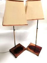 A pair of Asian interior table top lamps raised on stands, height including shades 85cm