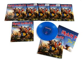 """Iron Maiden 7"""" Singles, seven copies of The Trooper on Blue Vinyl with Poster released 2002 on"""