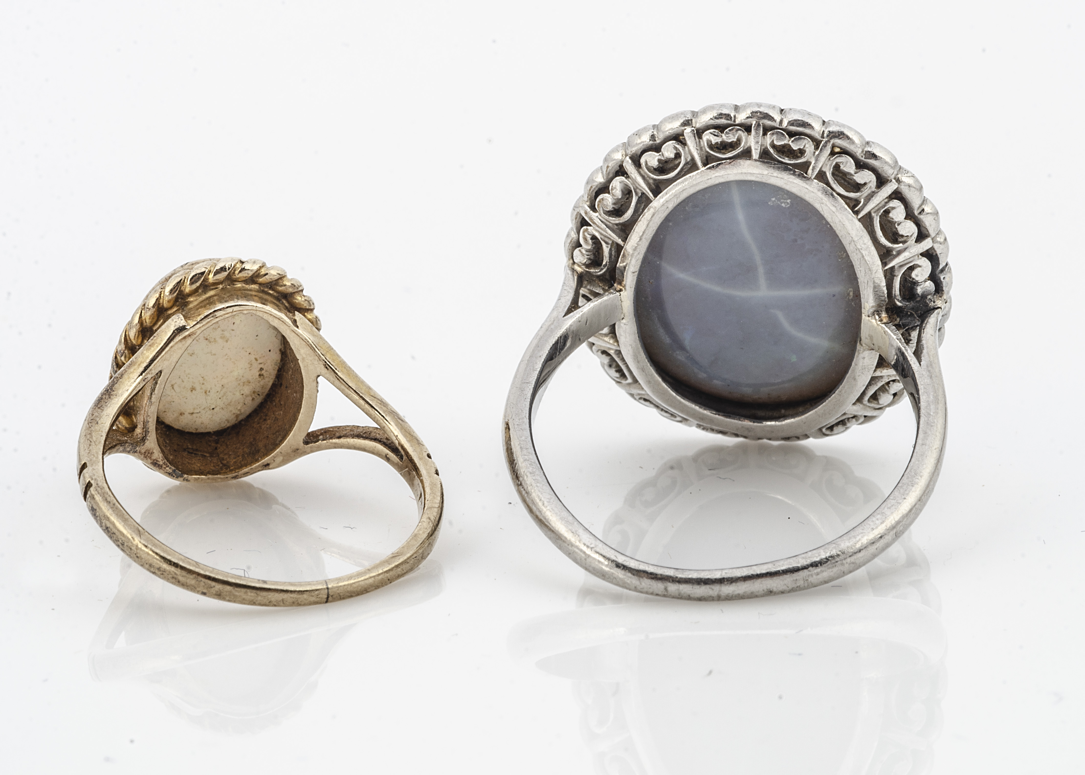 A large black opal and diamond bezel set dress ring, in white metal, the oval black opal with old - Image 2 of 2