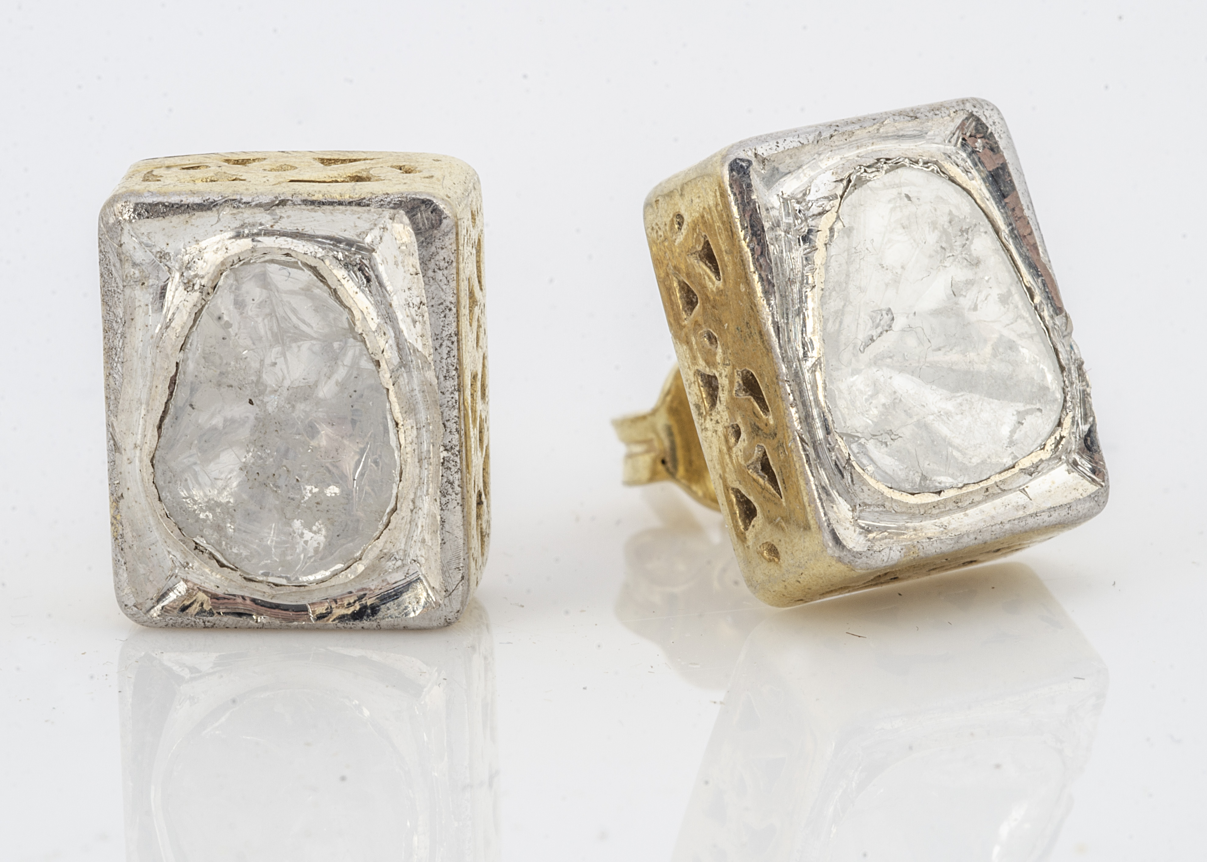 A pair of silver gilt and diamond slither stud earrings, in rubbed over settings of rectangular