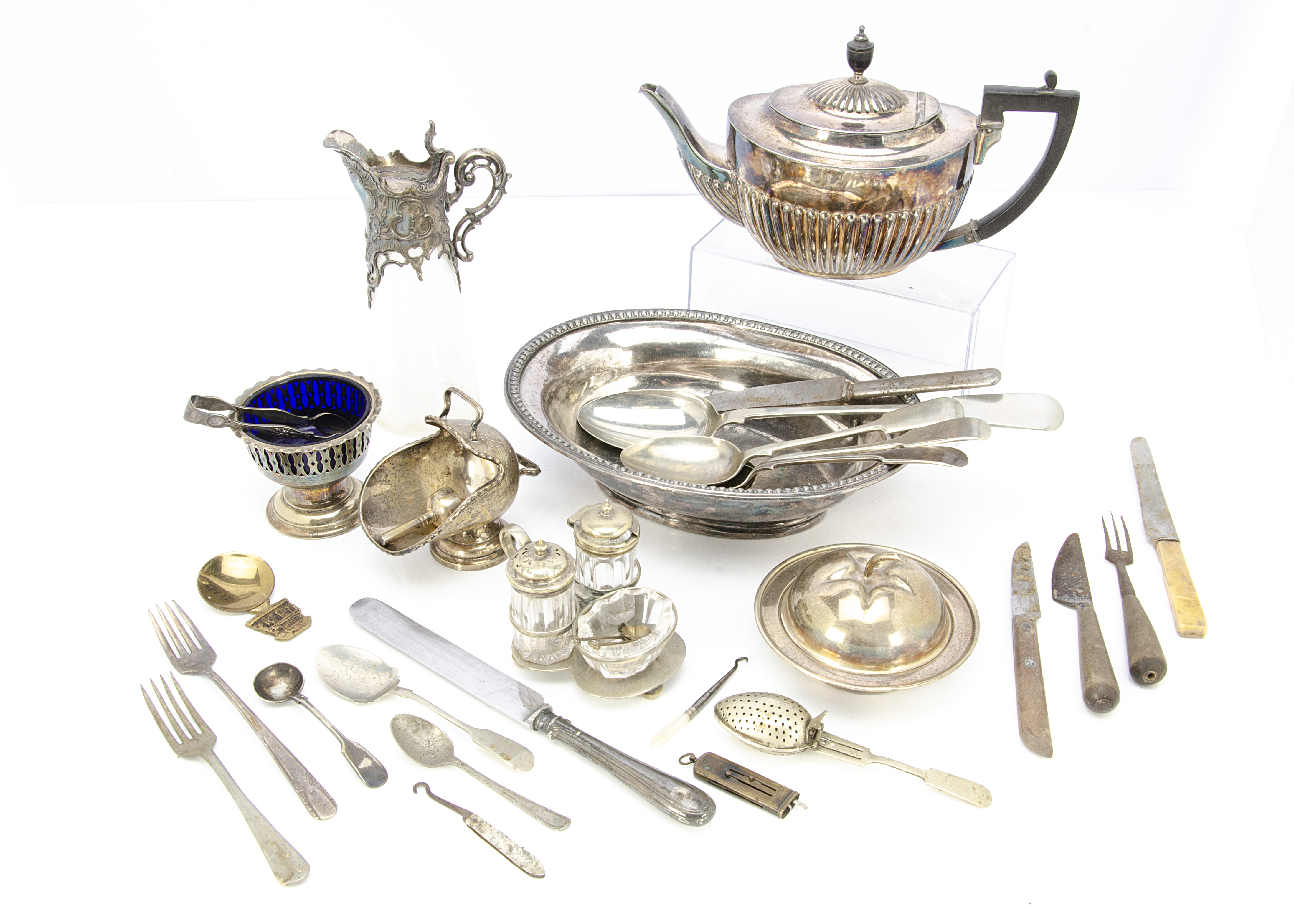 A collection of silver plated items, including a glass and silver plated claret jug, cruet set and