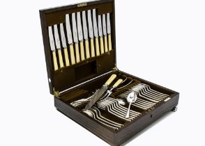 An Art Deco period silver plated canteen of cutlery from Mappin & Webb, in oak presentation case,