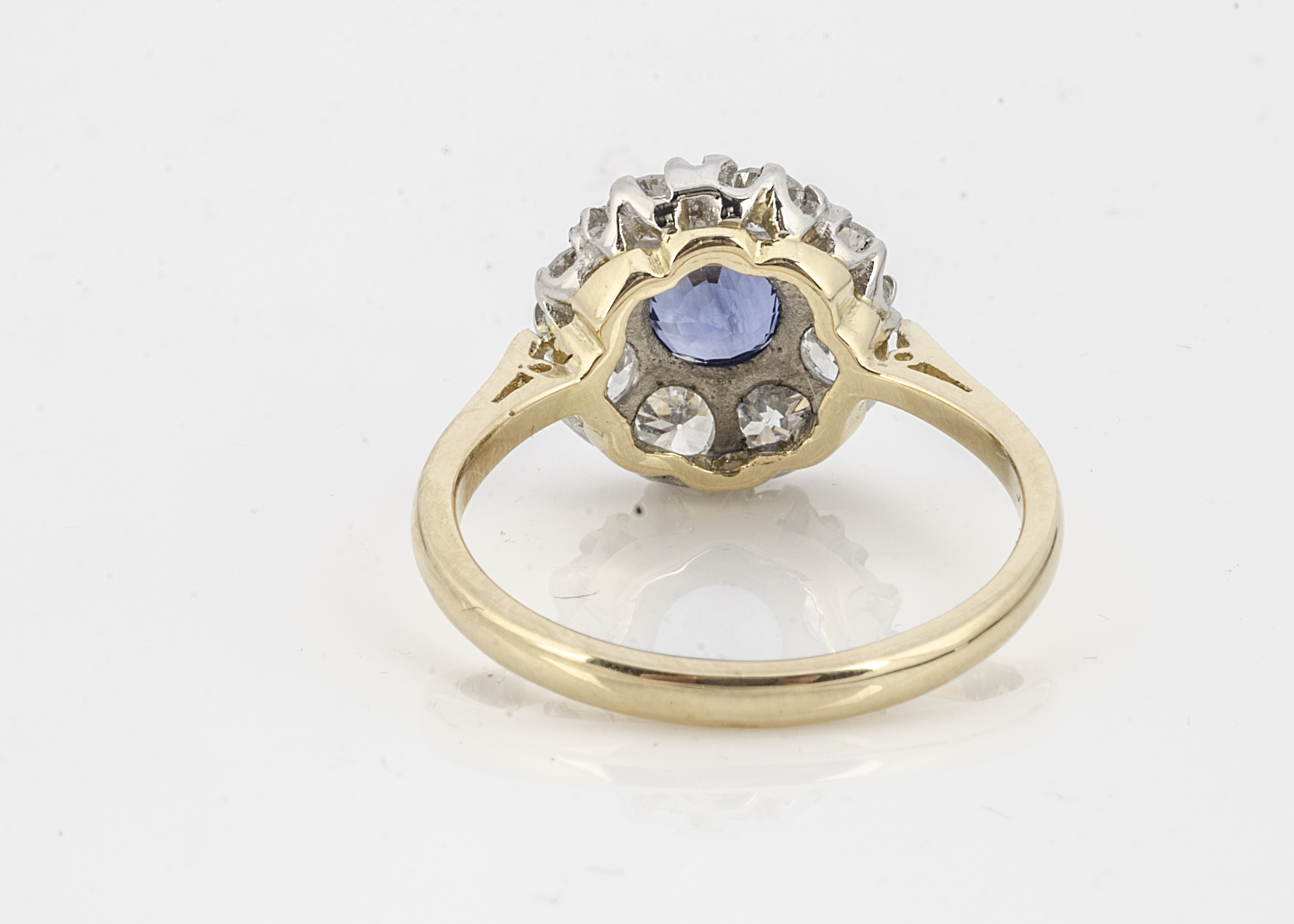 A yellow gold and sapphire and diamond set cluster ring, the circular mixed cut central sapphire - Image 2 of 2
