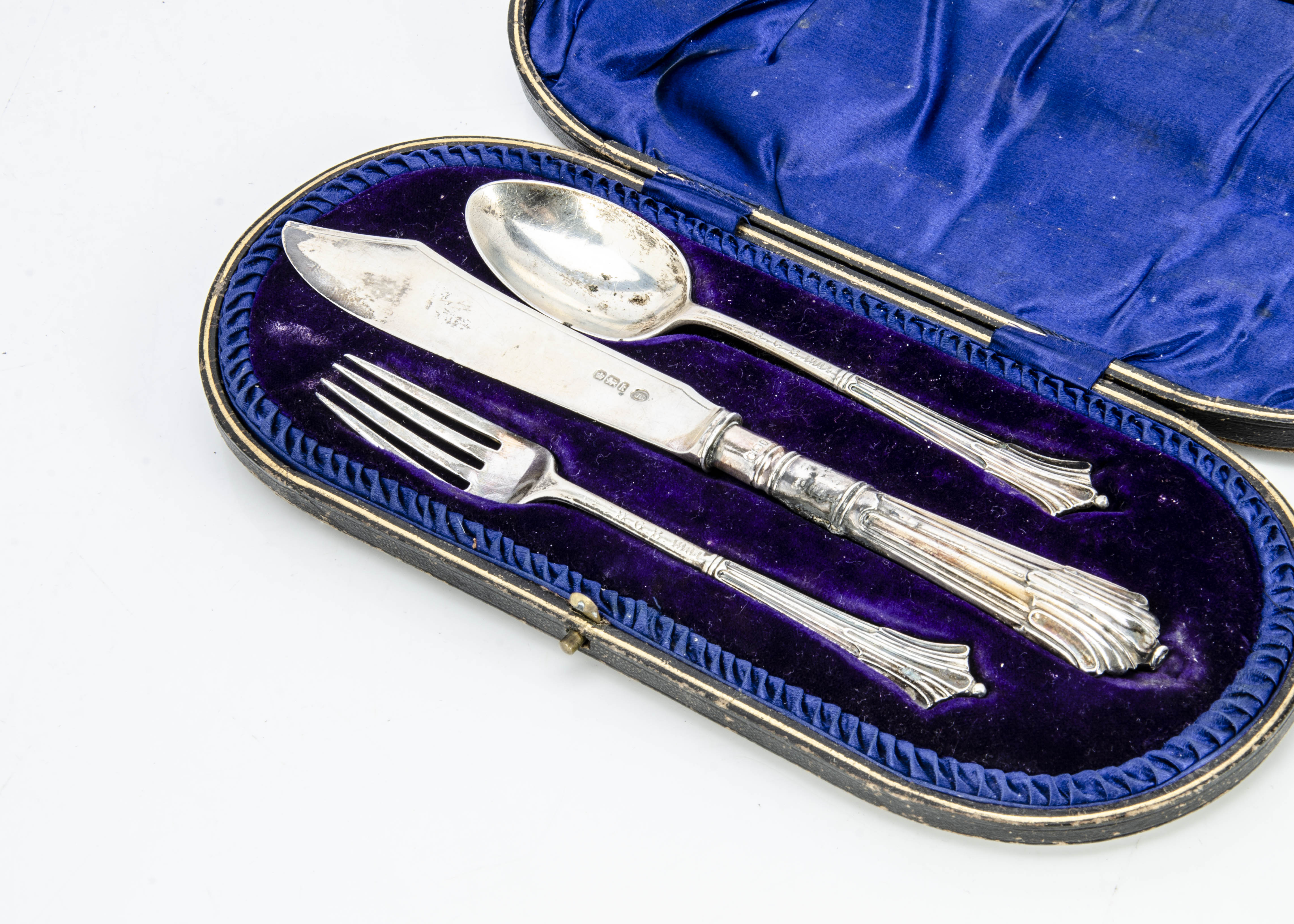 An Edwardian three piece silver Christening set by John Round & Son, in fitted box, with knife,