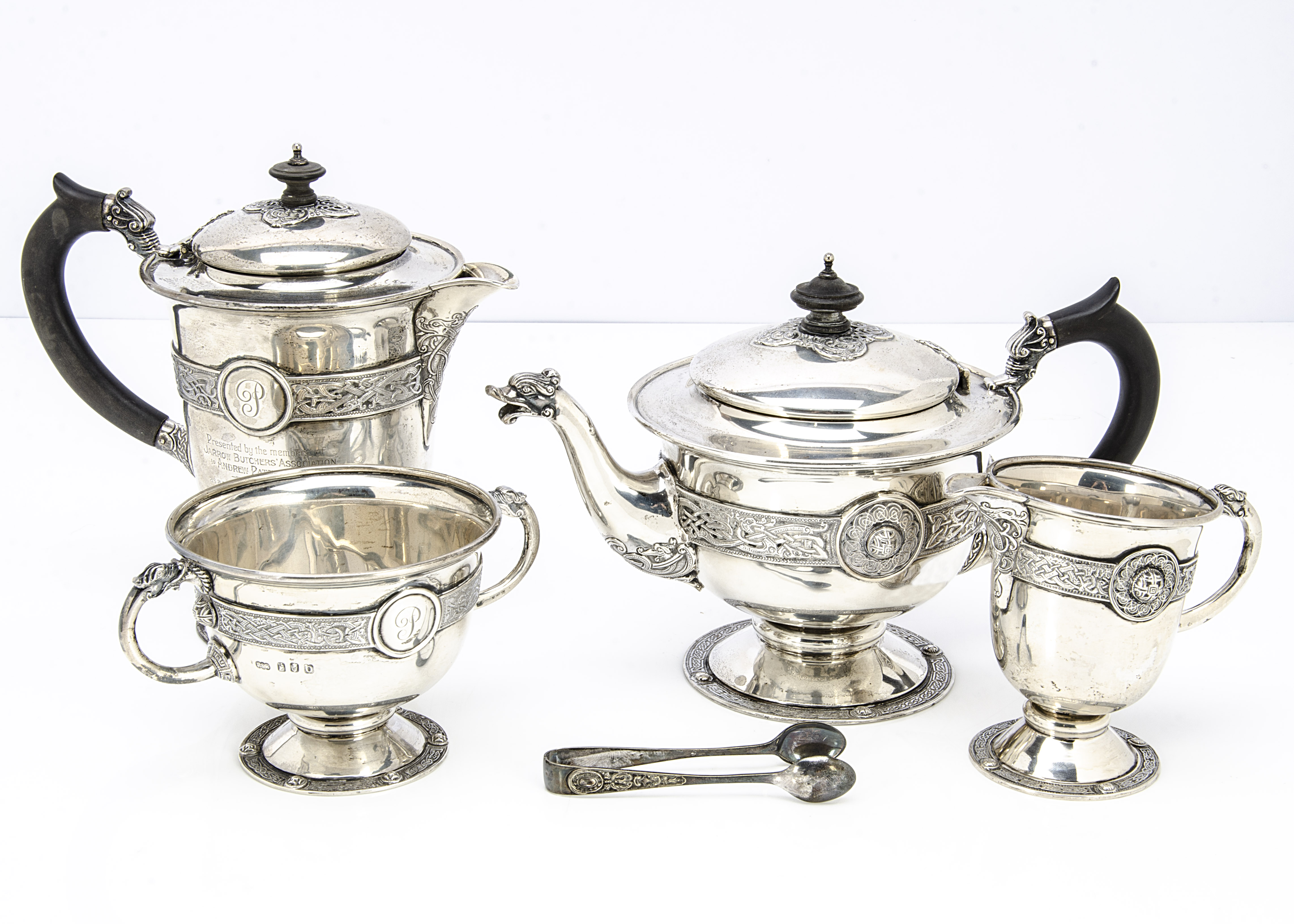 An early 20th Century four piece Irish silver tea service by Reid & Sons of Newcastle, comprising