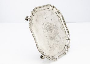 A George V silver presentation salver from H S Ltd, on four scroll supports, bearing inscription