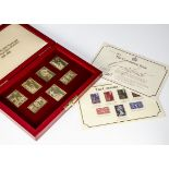 A 1970s set of seven silver gilt stamp ingots, celebrating the Queen's 25th anniversary of her