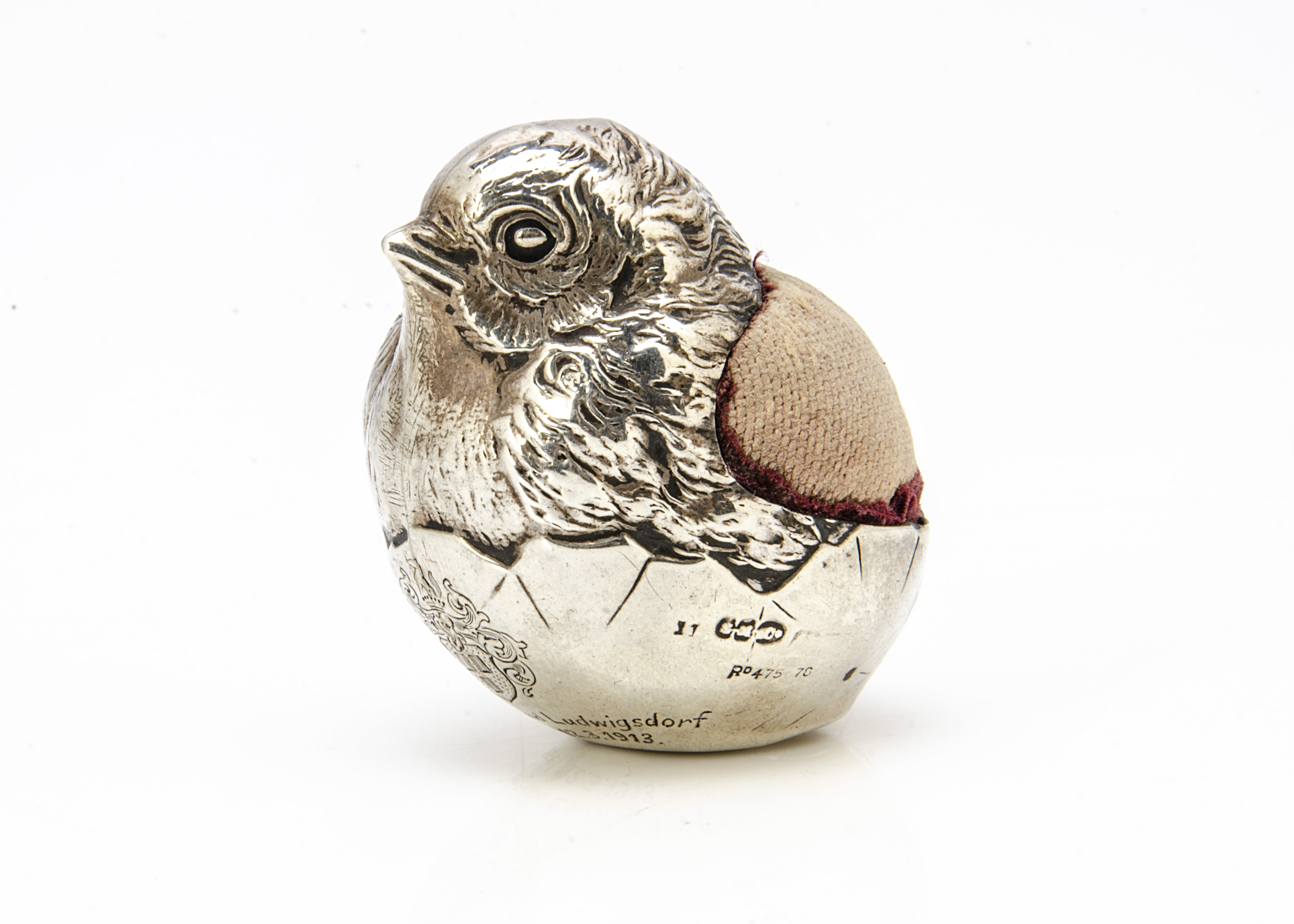 An Edwardian silver filled novelty pin cushion by Sampson Mordan & Co, in the form of a chick