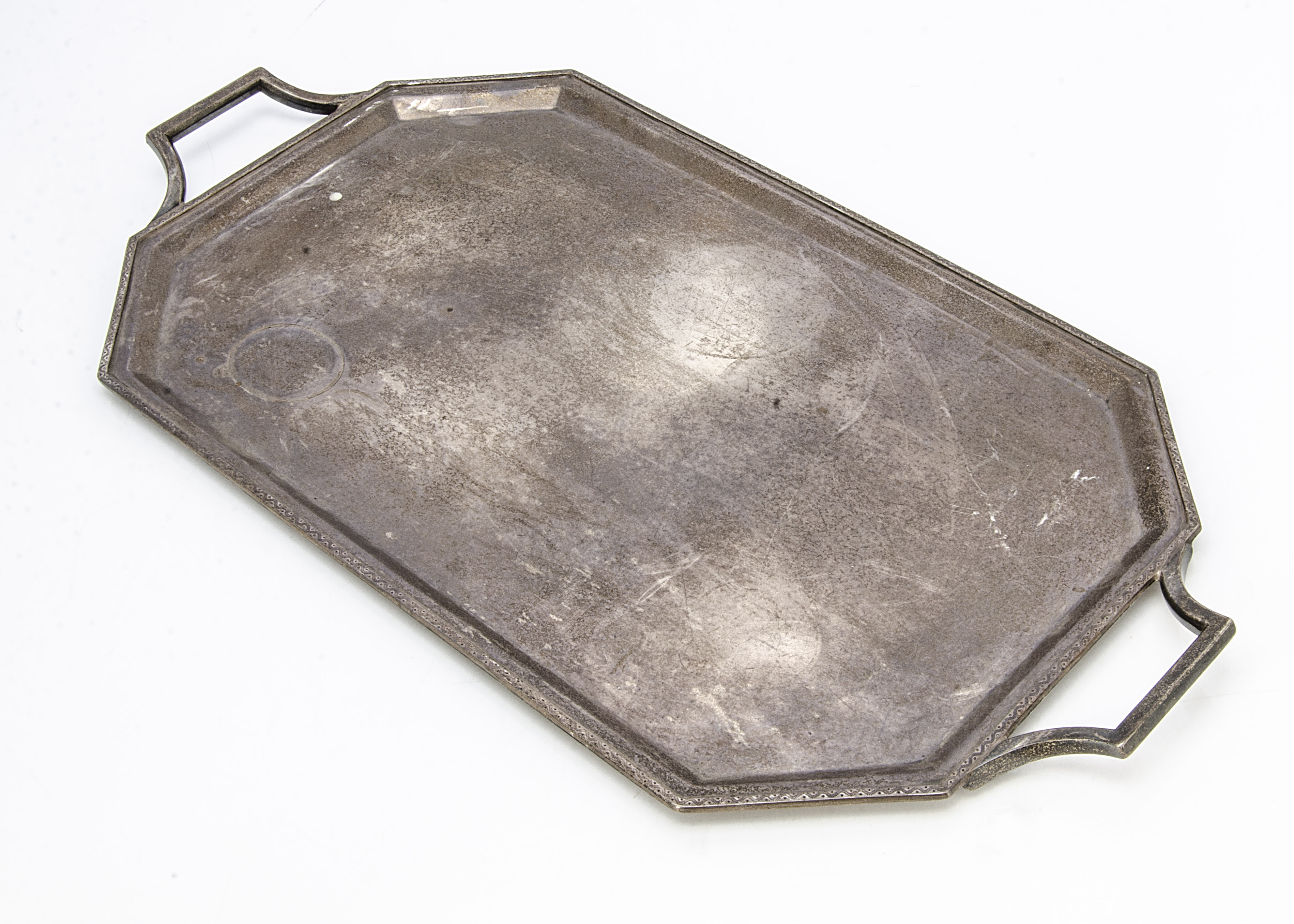 An Art Deco period silver tray by R & S, twin handled octagonal with wavy design to rim, 39.4 ozt