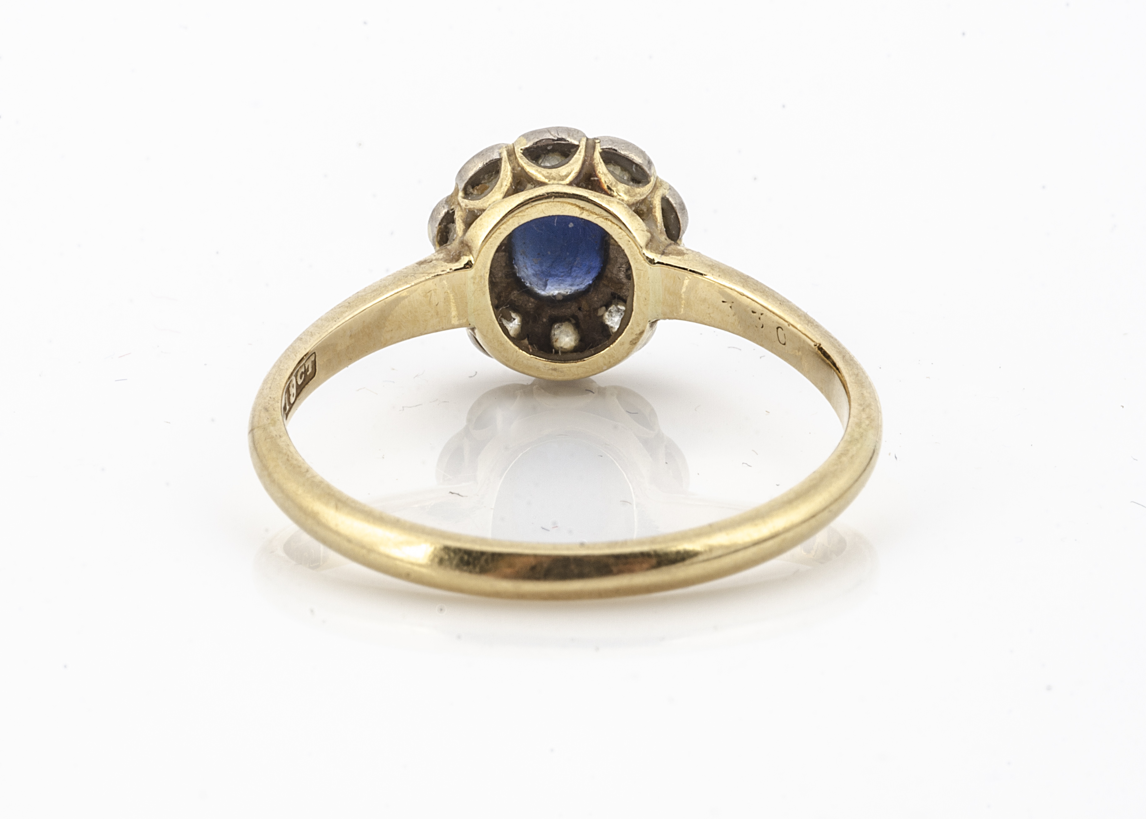A sapphire and diamond cluster ring, the oval mixed cut sapphire heavily abraded, in claw setting - Image 2 of 2