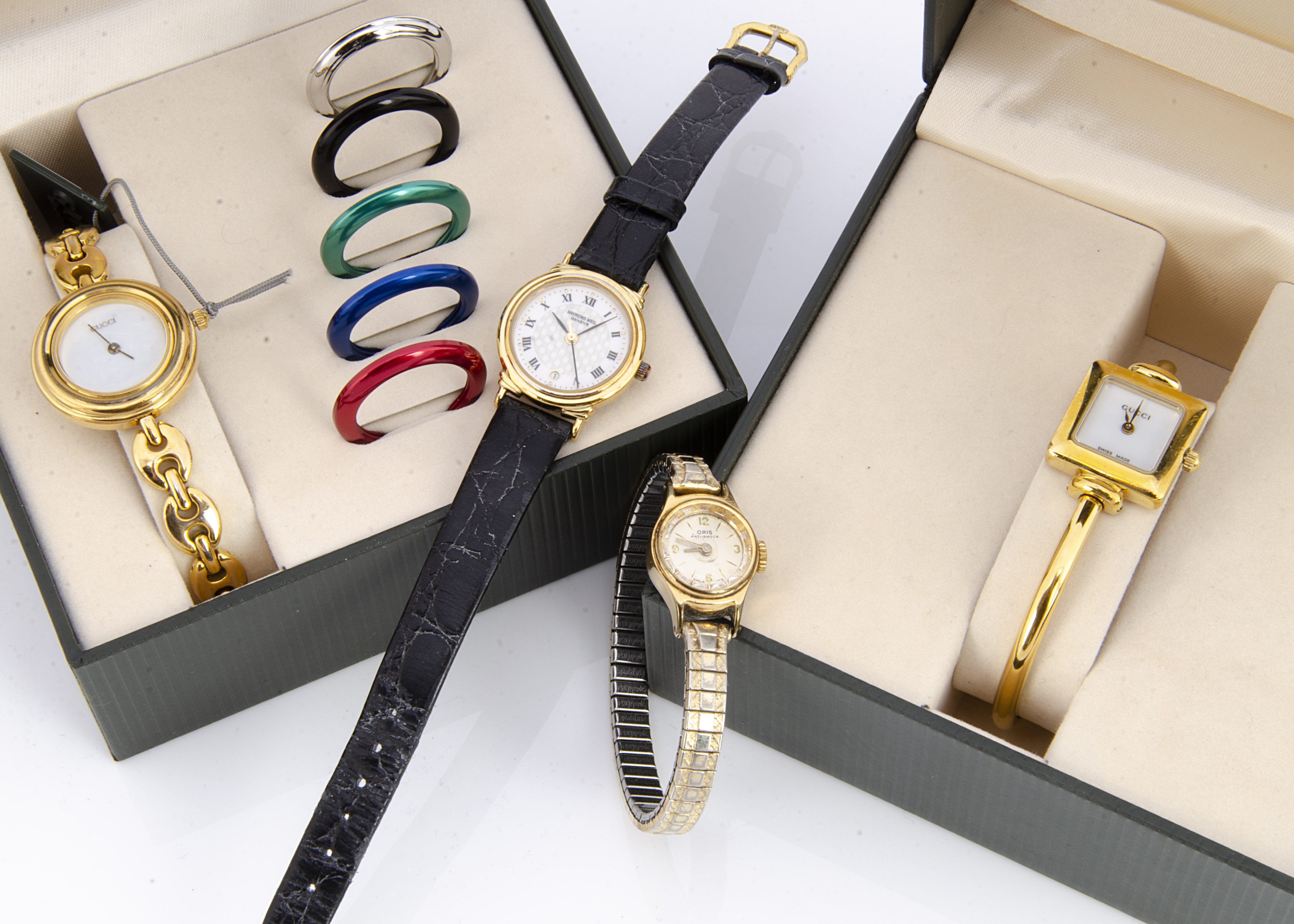 Four ladies wristwatches, including a gilt Raymond Weil on black leather strap in in black pouch,