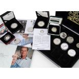 A collection of modern silver and other coins, including a Royal Mint 2008 Prince of Wales and a
