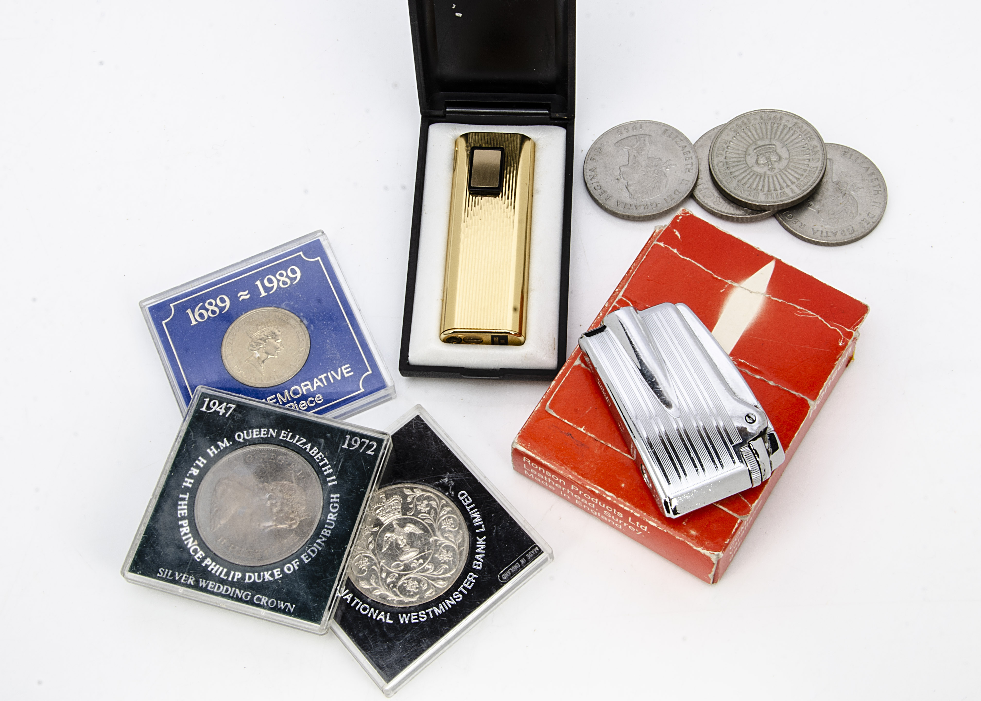 A collection of crowns, together with several £2 coins and two lighters