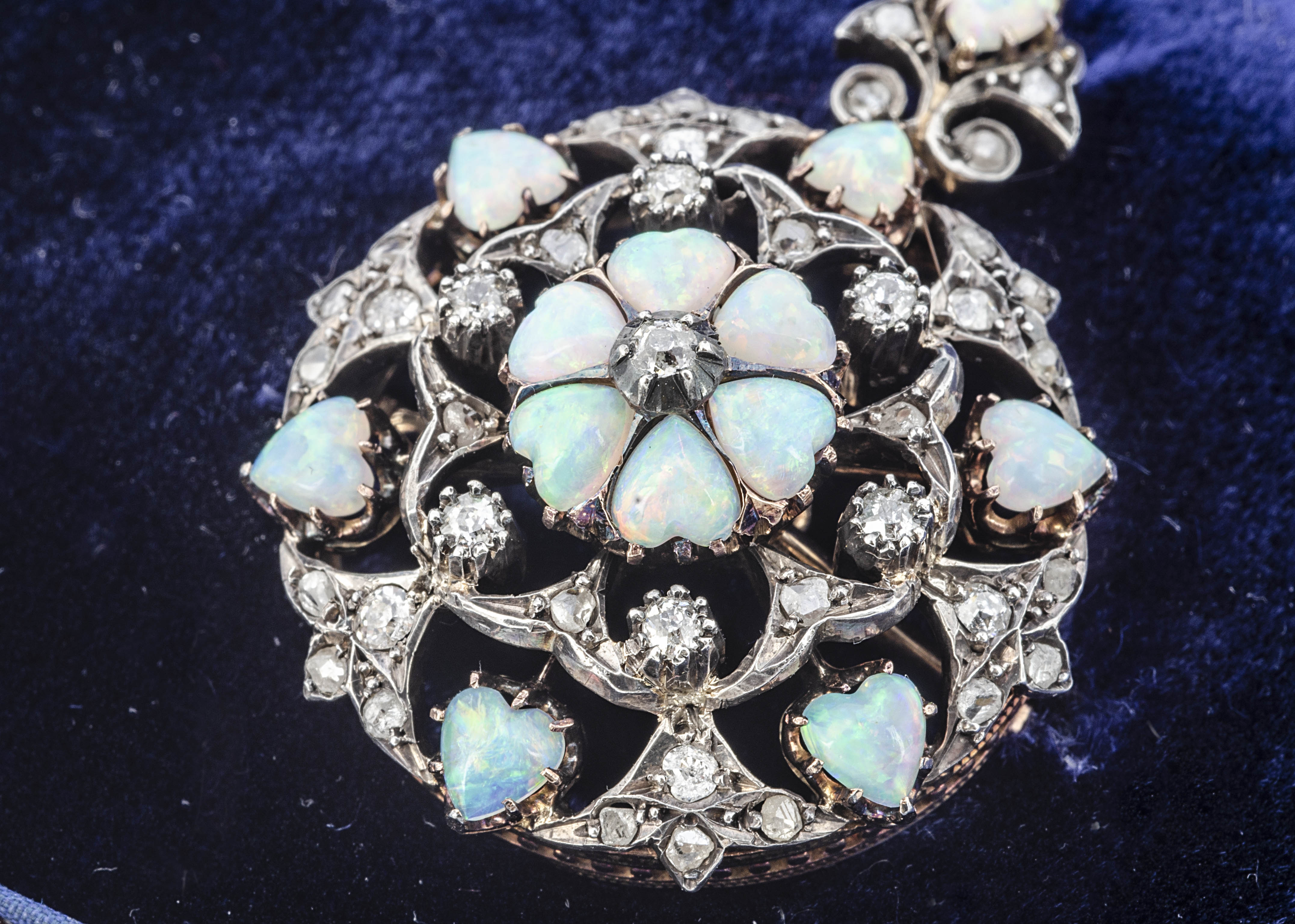 An Edwardian circular opal and diamond brooch or pendant, of target shape with central flower head - Image 2 of 2