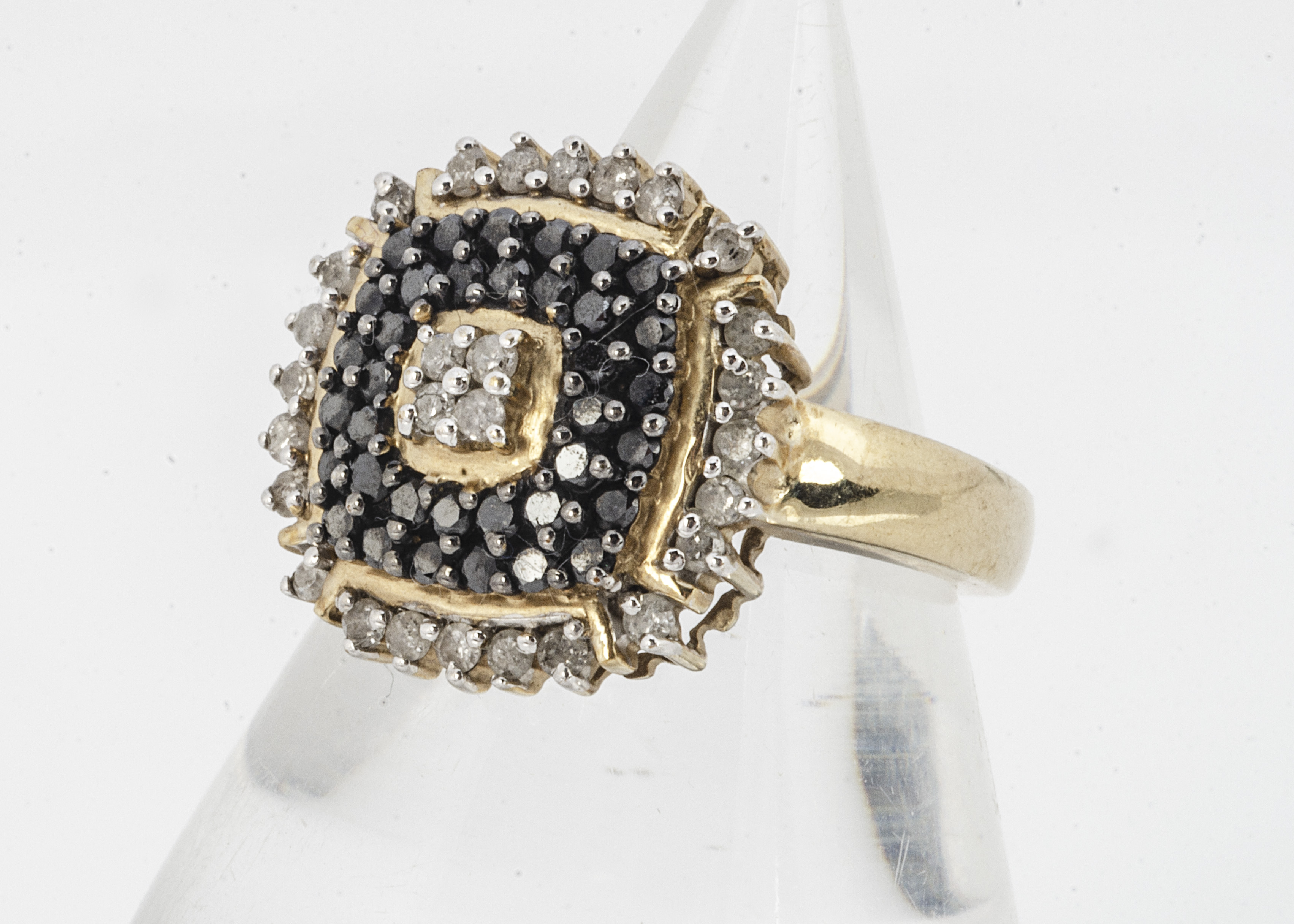 A 9ct gold black and colourless diamond cluster ring, of square tablet form, ring size P, 5g