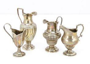 A group of four 19th and 20th Century silver jugs, 11.5 ozt, some denting and damages (4)