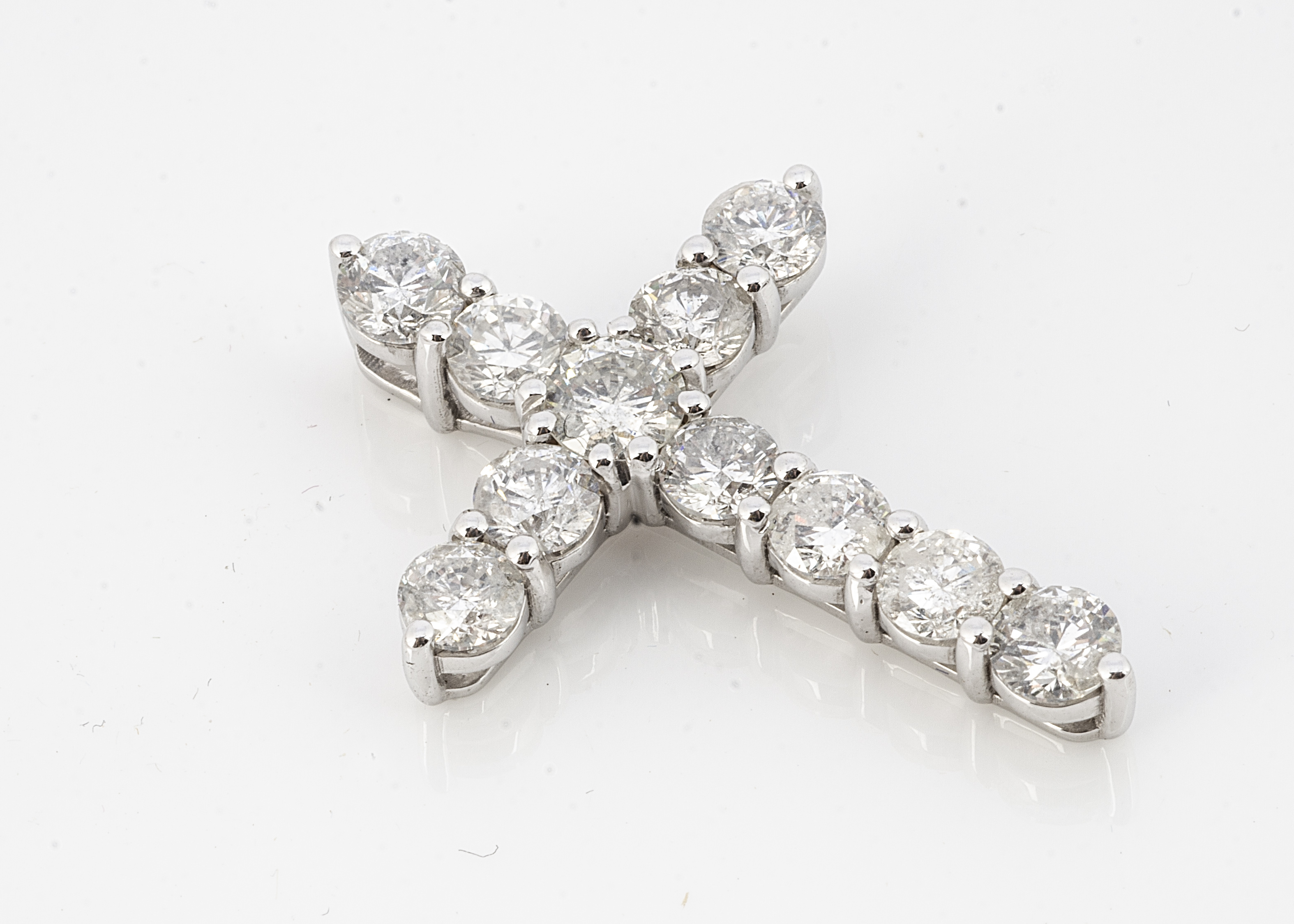 A diamond set cross pendant, the brilliant cuts in claw setting on an 18ct white gold hallmarked